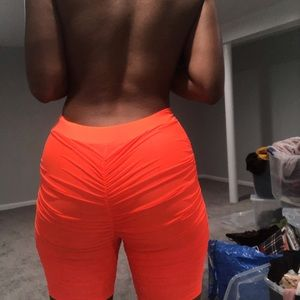 Fashion Nova Neon Orange Ruched Shorts